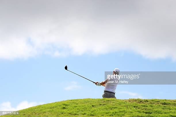 Justin Thomas of the United States plays his shot from the fifth tee during the third round of the SBS Tournament of Champions at the Plantation...