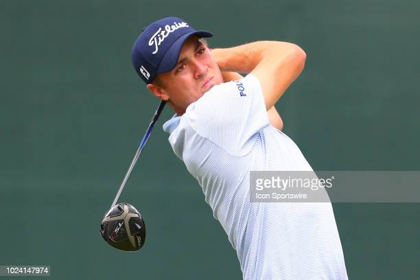 Justin Thomas of the United States plays his shot from the first tee during the third round of The Northern Trust on August 25, 2018 at the Ridgewood...