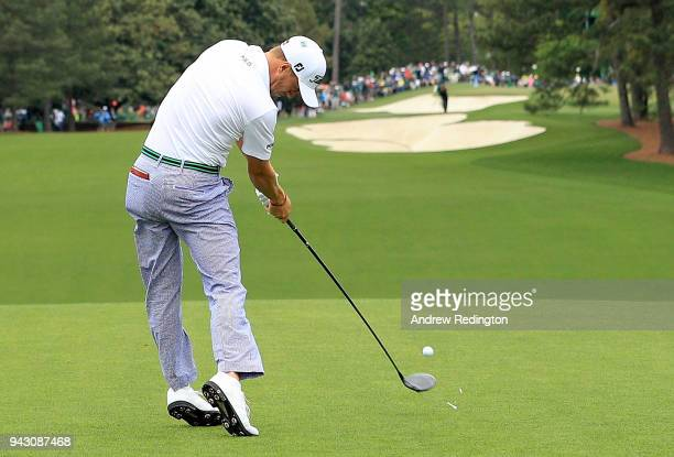 Justin Thomas of the United States plays his shot from the first tee during the third round of the 2018 Masters Tournament at Augusta National Golf...
