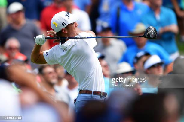 Justin Thomas of the United States plays his shot from the fourth tee during the first round of the 2018 PGA Championship at Bellerive Country Club...