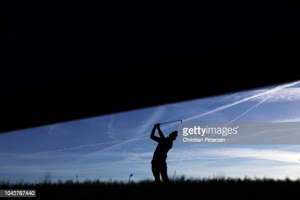 Justin Thomas of the United States plays his shot from the second tee during the morning fourball matches of the 2018 Ryder Cup at Le Golf National...