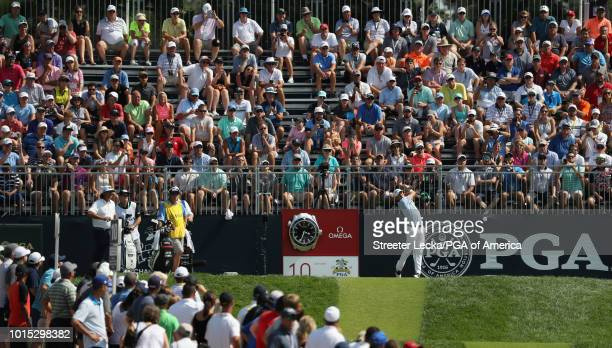 Justin Thomas of the United States plays his shot from the tenth tee during the third round of the 2018 PGA Championship at Bellerive Country Club on...