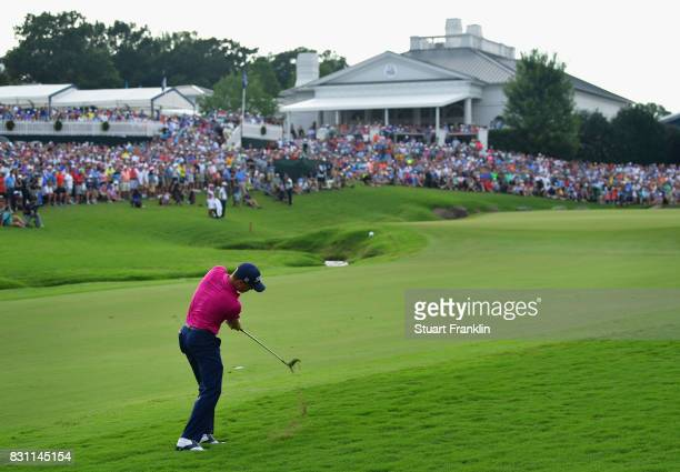 Justin Thomas of the United States plays his shot on the 18th hole during the final round of the 2017 PGA Championship at Quail Hollow Club on August...