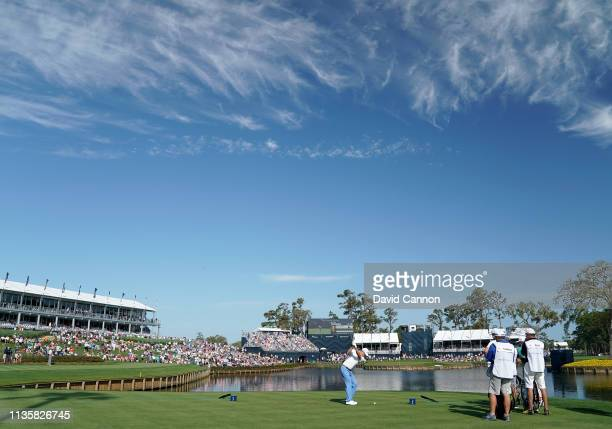 Justin Thomas of the United States plays his tee shot on the par 3 17th hole during the first round of the 2019 Players Championship held on the...