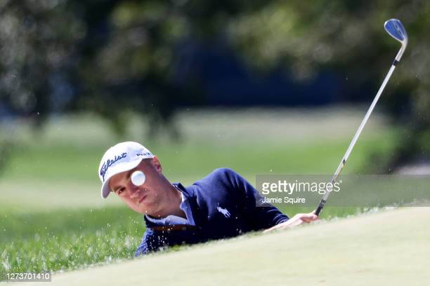 Justin Thomas of the United States plays his third shot from a greenside bunker on the first hole during the final round of the 120th U.S. Open...
