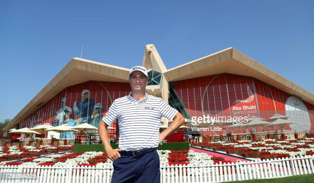 Justin Thomas of the United States poses for a portrait in front of the club house ahead of the Abu Dhabi HSBC Championship at Abu Dhabi Golf Club on...