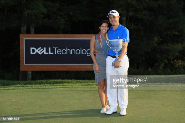Justin Thomas of the United States poses with girlfriend Jillian Wisniewski after winning the Dell Technologies Championship at TPC Boston on...