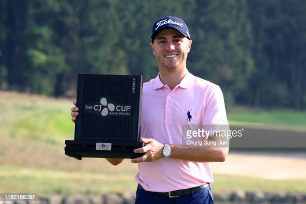 Justin Thomas of the United States poses with the trophy after winning the tournament during the final round of the CJ Cup @Nine Bridges at the Club...