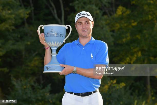Justin Thomas of the United States poses with the trophy after winning the Dell Technologies Championship at TPC Boston on September 4, 2017 in...