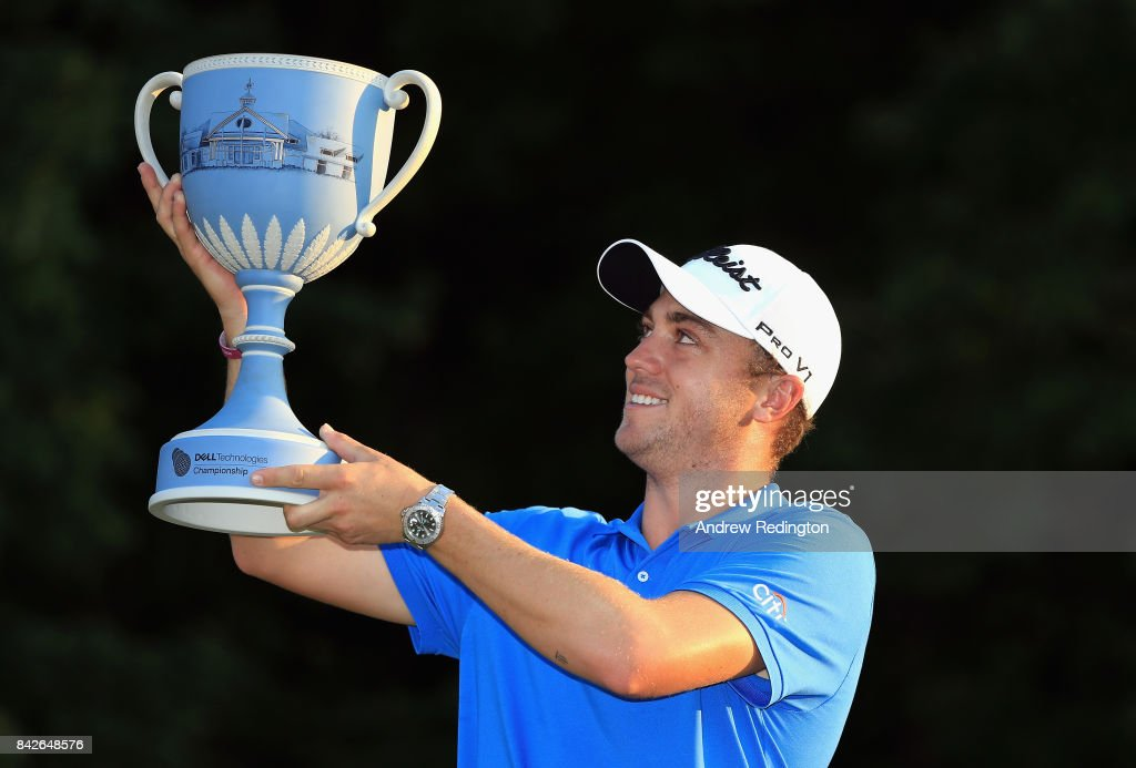 Justin Thomas of the United States poses with the trophy after winning the Dell Technologies Championship at TPC Boston on September 4, 2017 in Norton, Massachusetts.