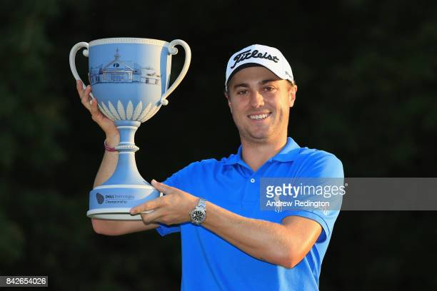 Justin Thomas of the United States poses with the trophy after winning the Dell Technologies Championship at TPC Boston on September 4 2017 in Norton...