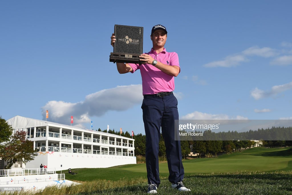 Justin Thomas of the United States poses with the trophy after winning the CJ Cup at Nine Bridges on October 22, 2017 in Jeju, South Korea.