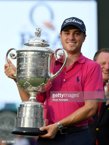 Justin Thomas of the United States poses with the Wanamaker Trophy after winning the 2017 PGA Championship at Quail Hollow Club on August 13 2017 in...