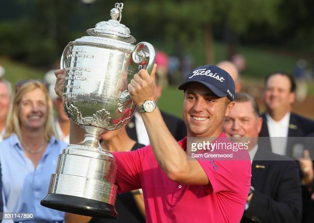 Justin Thomas of the United States poses with the Wanamaker Trophy after winning the 2017 PGA Championship during the final round at Quail Hollow...