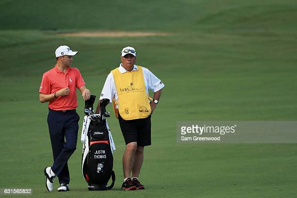 Justin Thomas of the United States prepares to play a shot on the tenth hole during the first round of the Sony Open In Hawaii at Waialae Country...