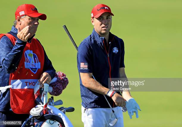 Justin Thomas of the United States prepares to play his second shot on the 10th hole in his match against Rory McIlroy of the European Team during...