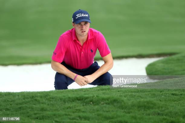 Justin Thomas of the United States prepares to play his shot out of the bunker on the 18th hole during the final round of the 2017 PGA Championship...