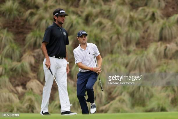 Justin Thomas of the United States putts as Bubba Watson of the United States looks on during the semifinal round of the World Golf ChampionshipsDell...