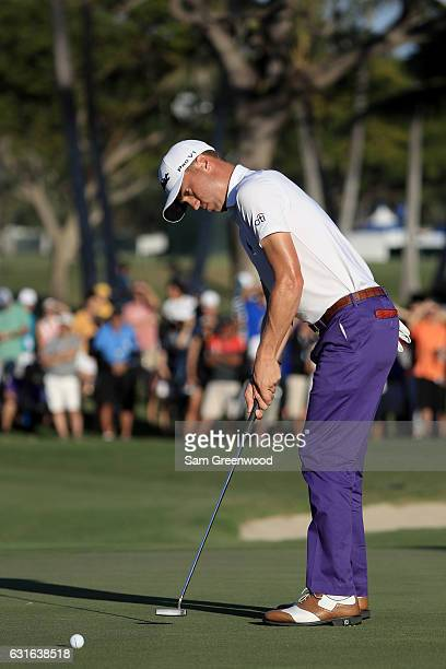 Justin Thomas of the United States putts for eagle on the 18th green during the second round of the Sony Open In Hawaii at Waialae Country Club on...