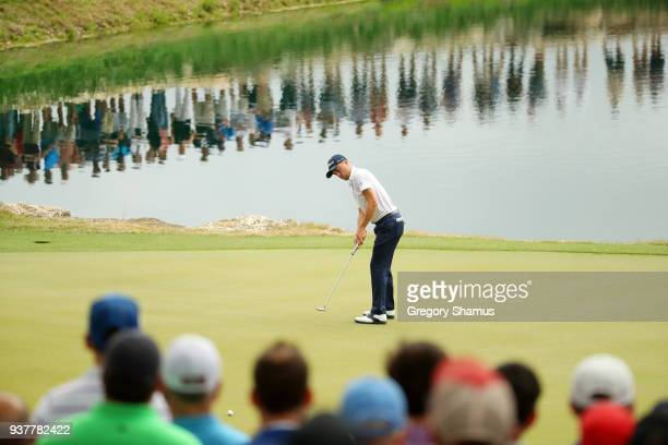 Justin Thomas of the United States putts on the 11th green during his semifinal round match against Bubba Watson of the United States in the World...