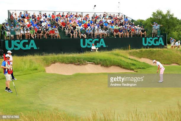 Justin Thomas of the United States putts on the 16th green during the third round of the 2017 US Open at Erin Hills on June 17 2017 in Hartford...