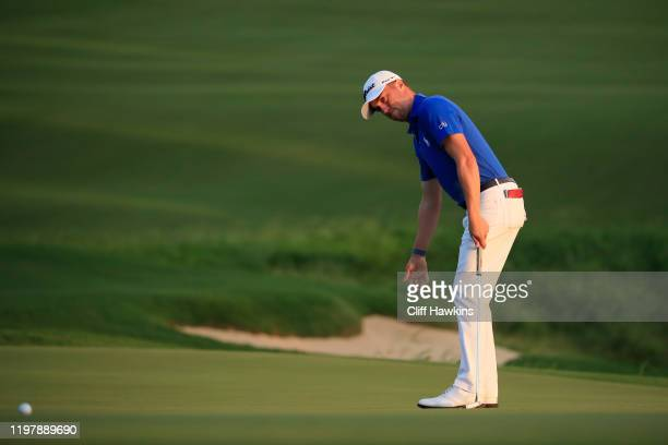 Justin Thomas of the United States putts on the 18th green during a playoff in the final round of the Sentry Tournament Of Champions at the Kapalua...