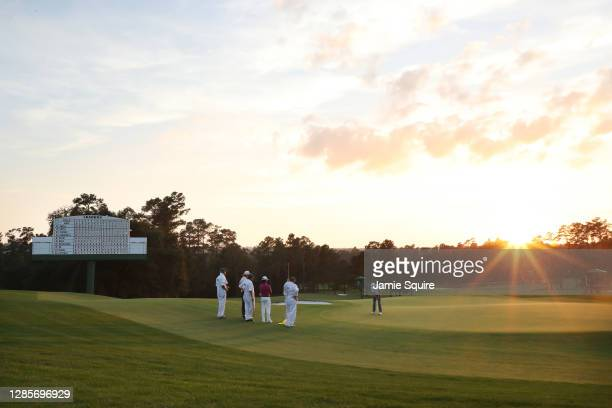 Justin Thomas of the United States putts on the 18th green during the third round of the Masters at Augusta National Golf Club on November 14, 2020...