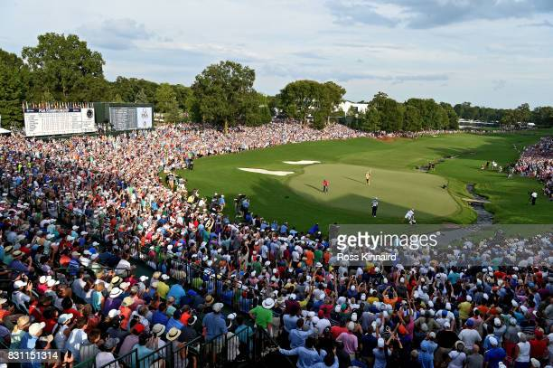 Justin Thomas of the United States putts on the 18th green during the final round of the 2017 PGA Championship at Quail Hollow Club on August 13 2017...