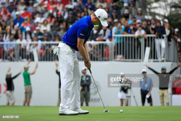 Justin Thomas of the United States putts on the 18th hole during the third round of the World Golf Championships Mexico Championship at Club De Golf...
