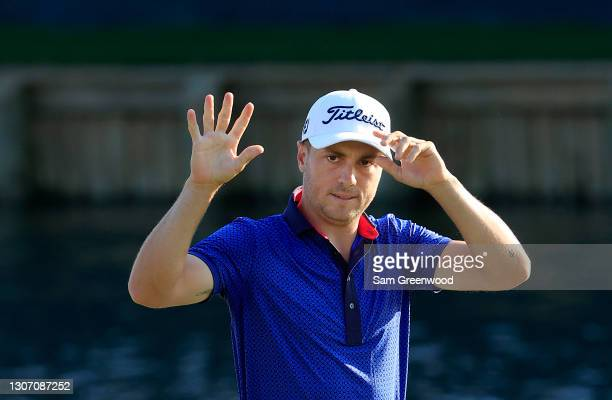 Justin Thomas of the United States reacts after finishing on his way to winning on the 18th green during the final round of THE PLAYERS Championship...