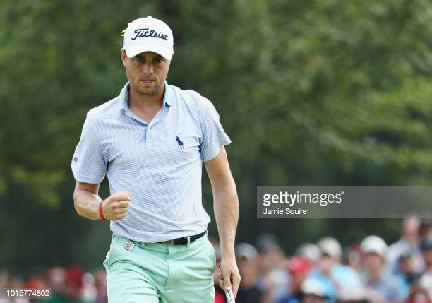 Justin Thomas of the United States reacts after making a putt for birdie on the tenth green during the final round of the 2018 PGA Championship at...