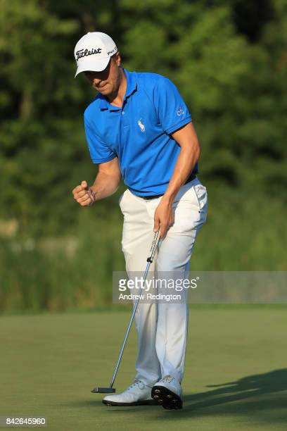 Justin Thomas of the United States reacts after making a putt for par on the 16th green during the final round of the Dell Technologies Championship...