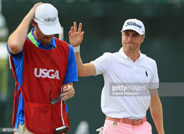Justin Thomas of the United States reacts after making an eagle on the 18th hole during the third round of the 2017 US Open at Erin Hills on June 17...