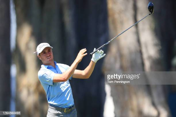 Justin Thomas of the United States reacts after playing his shot from the second tee during the second round of the 2020 PGA Championship at TPC...