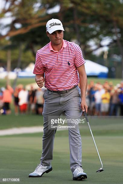 Justin Thomas of the United States reacts after putting for birdie on the 18th green during the third round of the Sony Open In Hawaii at Waialae...