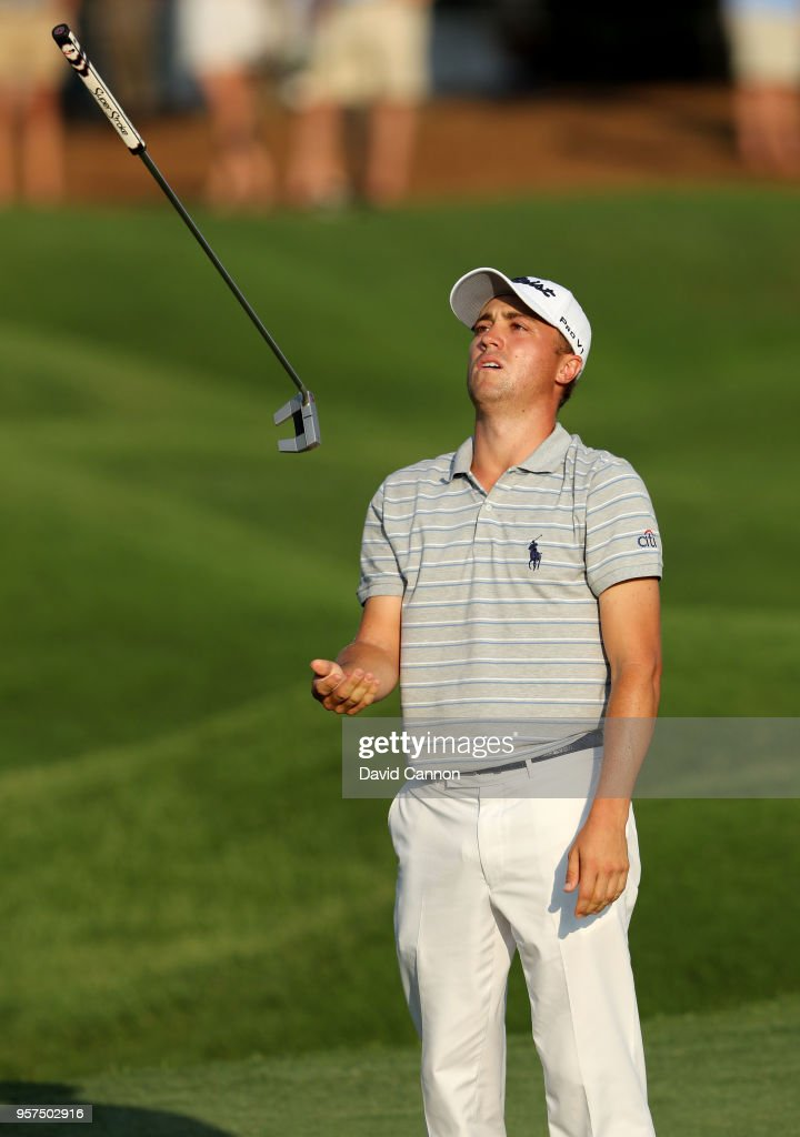 Justin Thomas of the United States reacts by throwing his putter after missing a par putt on the par 4, 18th hole during the second round of the THE PLAYERS Championship on the Stadium Course at TPC Sawgrass on May 11, 2018 in Ponte Vedra Beach, Florida.