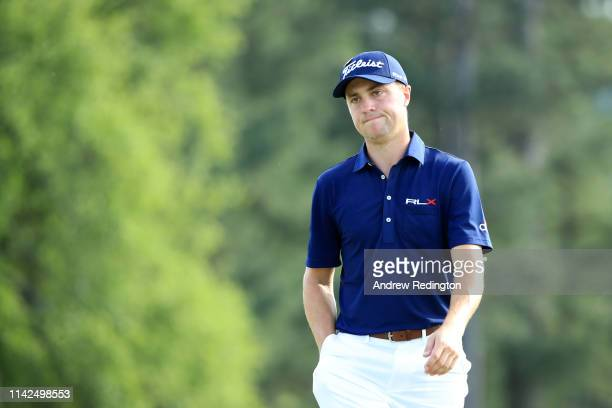Justin Thomas of the United States reacts on the 18th hole during the third round of the Masters at Augusta National Golf Club on April 13 2019 in...