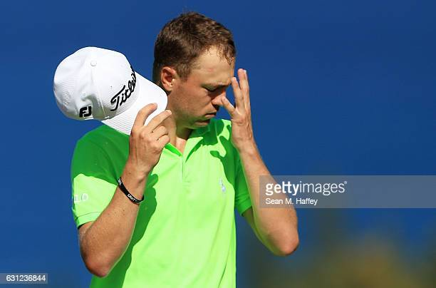 Justin Thomas of the United States reacts on the fourth green during the final round of the SBS Tournament of Champions at the Plantation Course at...