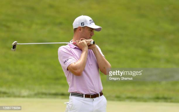 Justin Thomas of the United States reacts to a missed putt on the 18th green during the second playoff hole during the final round of the Workday...