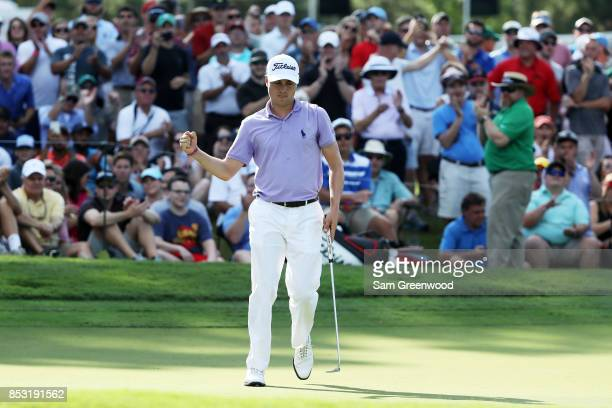 Justin Thomas of the United States reacts to his birdie on the 16th green during the final round of the TOUR Championship at East Lake Golf Club on...