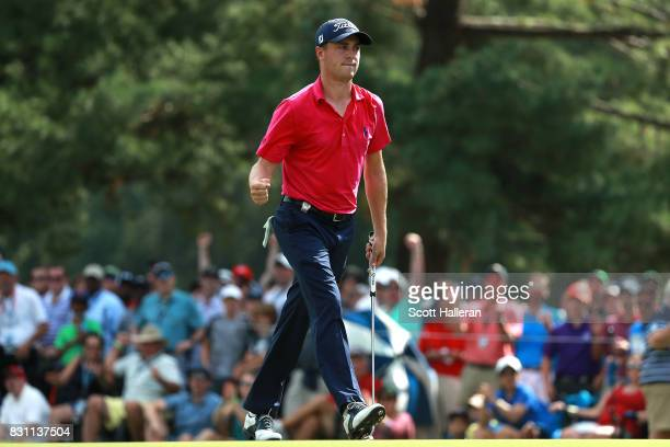 Justin Thomas of the United States reacts to his birdie putt on the ninth green during the final round of the 2017 PGA Championship at Quail Hollow...