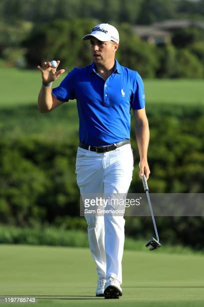 Justin Thomas of the United States reacts to his putt on the 17th green during the final round of the Sentry Tournament Of Champions at the Kapalua...