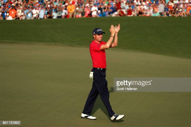 Justin Thomas of the United States reacts to his putt on the 18th green with -8 finish during the final round of the 2017 PGA Championship at Quail...