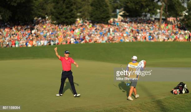 Justin Thomas of the United States reacts to his putt on the 18th green with 8 finish during the final round of the 2017 PGA Championship at Quail...