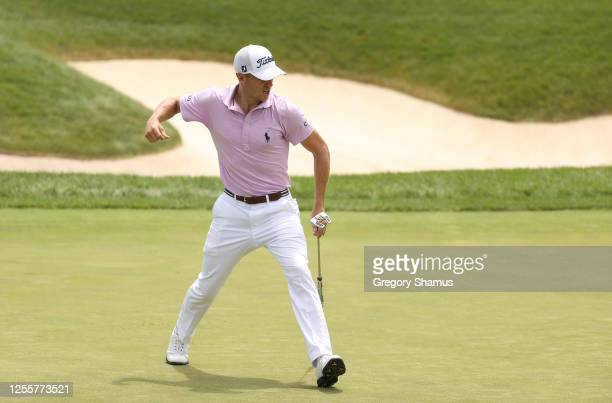 Justin Thomas of the United States reacts to his putt on the 18th green during a playoff during the final round of the Workday Charity Open on July...