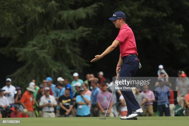 Justin Thomas of the United States reacts to his putt on the third green during the final round of the 2017 PGA Championship at Quail Hollow Club on...