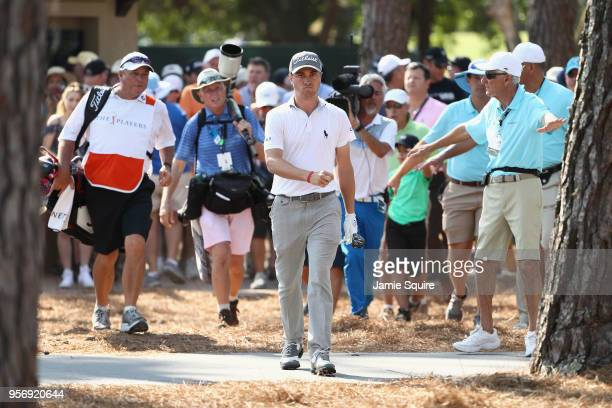 Justin Thomas of the United States reacts to his second shot on the 15th hole during the first round of THE PLAYERS Championship on the Stadium...