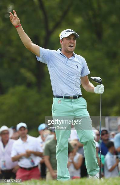 Justin Thomas of the United States reacts to his shot from the 12th tee during the final round of the 2018 PGA Championship at Bellerive Country Club...