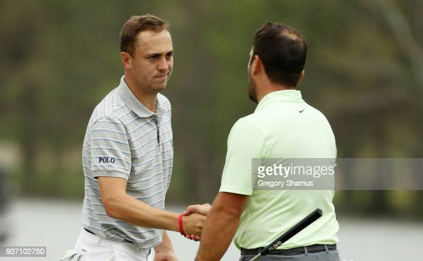 Justin Thomas of the United States shakes hands with Francesco Molinari of Italy after defeating him 75 on the 13th green during the third round of...