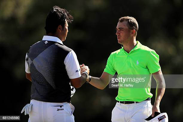 Justin Thomas of the United States shakes hands with Hideki Matsuyama of Japan after winning during the final round of the SBS Tournament of...